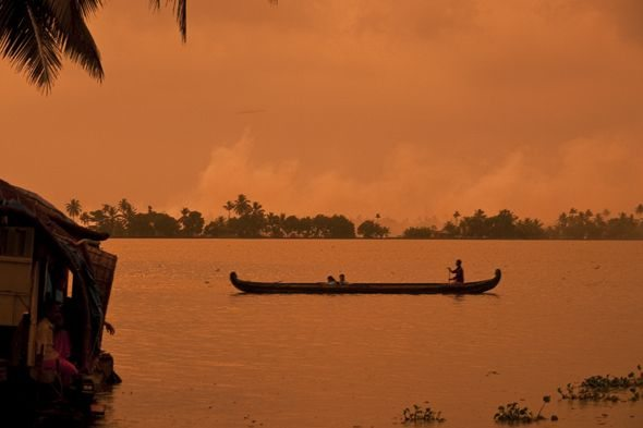 sunset in Kerala with man on boat