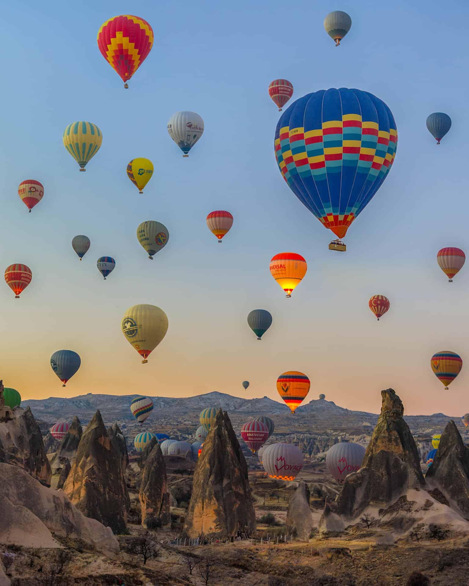 cappadocia turkey hot air baloons over fairy chimneys