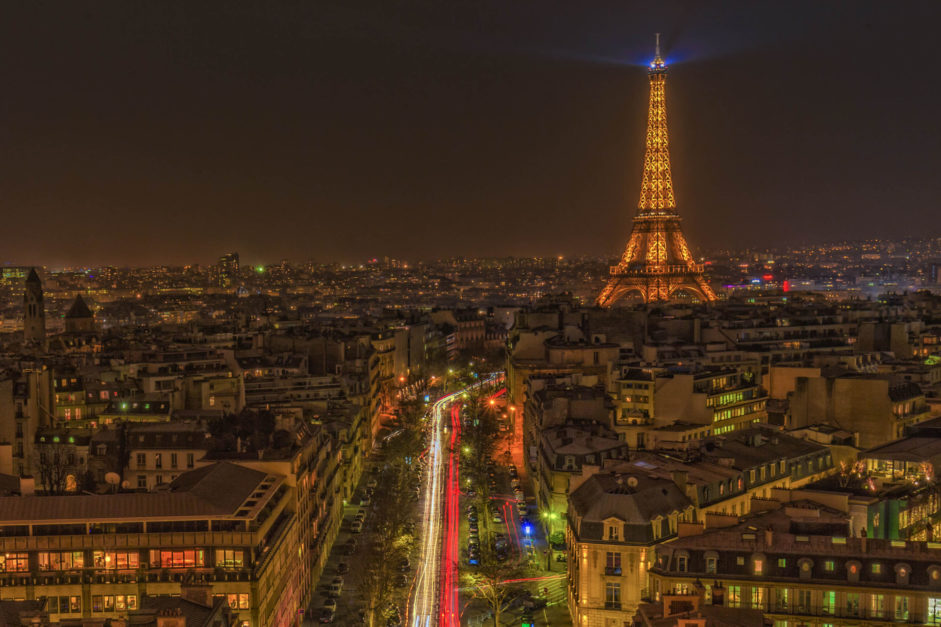 eiffel tower and champs elysees lights at night