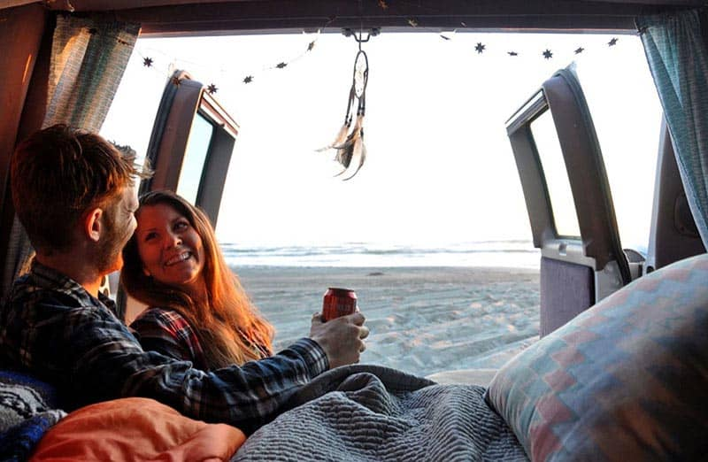living in a campervan relaxing on the beach