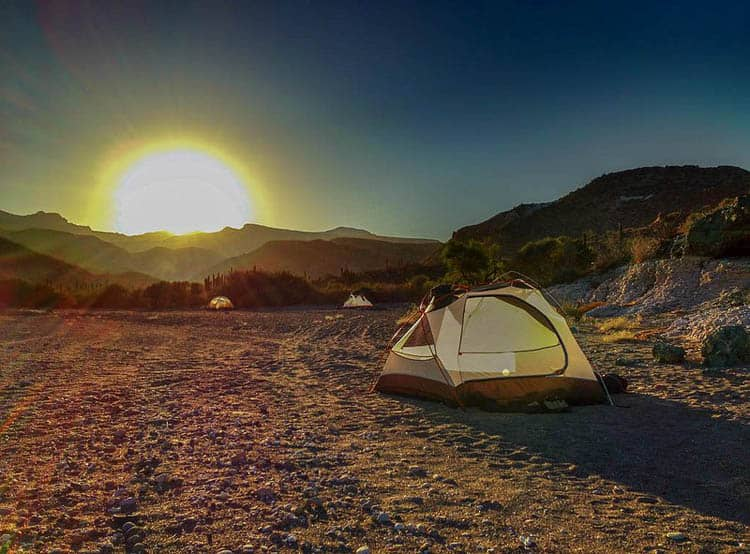 camping hacks and tips | tent at sunset