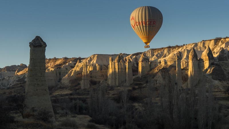 cappadocia hot air balloon with sun
