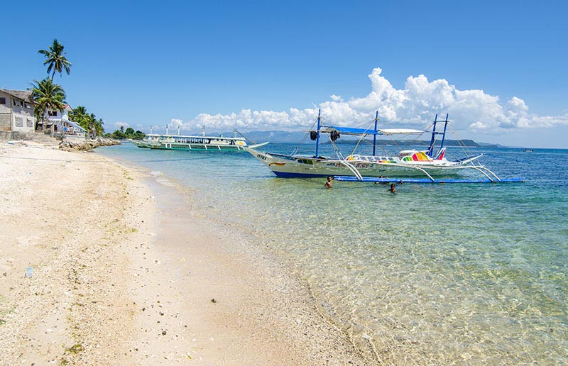 carabao island boats at beach