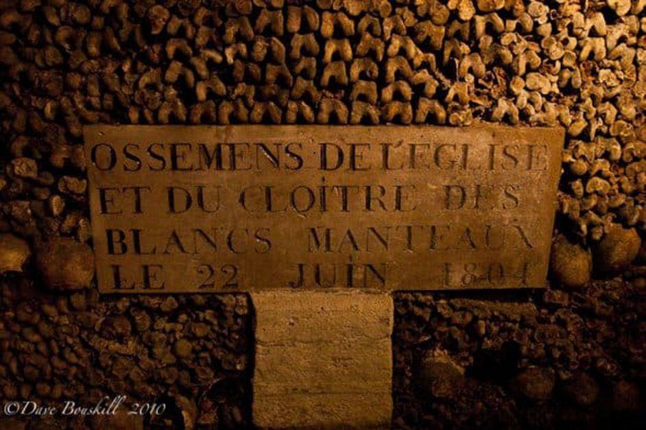 plaque at bones of the catacombs in paris france