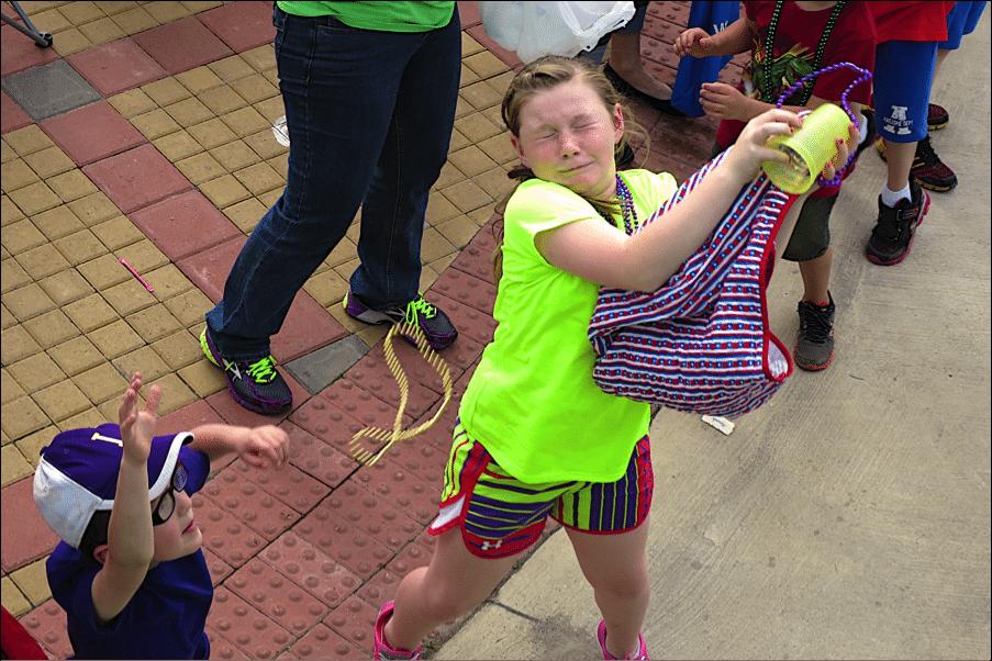 Catching Beads at Mardi Gras