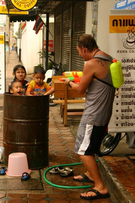 Kids have a water fight at Songkran