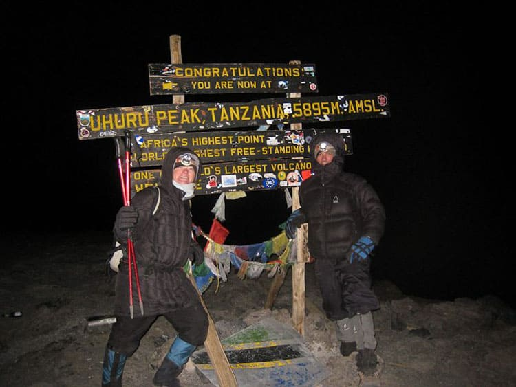 reaching the summit of mount kilimanjaro