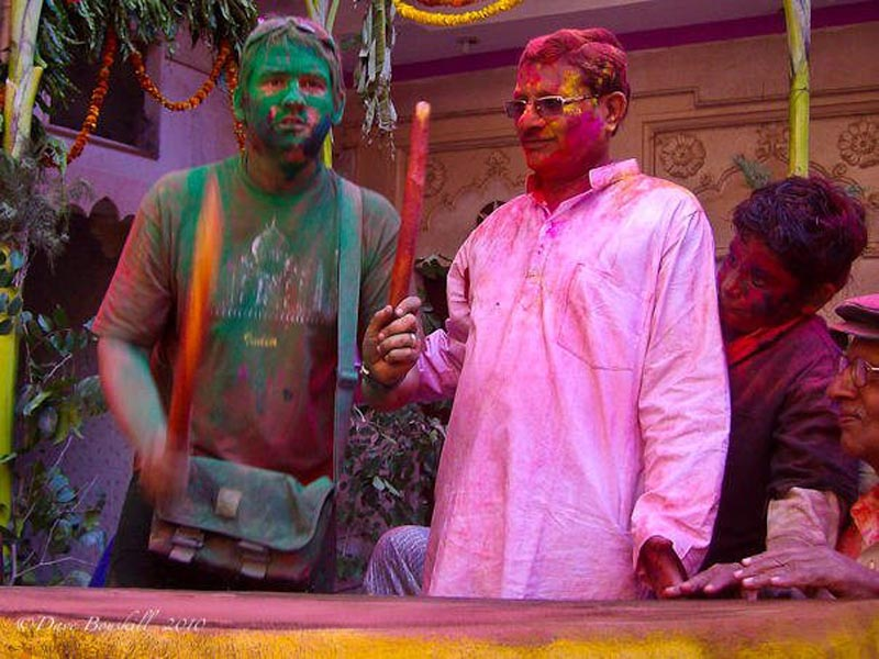 dave drumming during holi celebrations in India