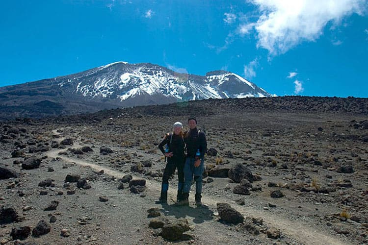 climb mount kilimanjaro | dave and deb with mountain in background