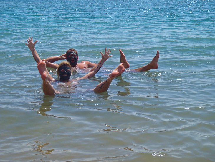 people floating in the dead sea of jordan