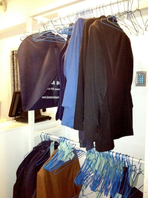 Secret Restaurant in Barcelona - clothes hanging in a drycleaner