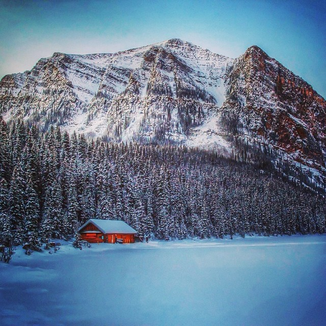 Cabin on frozen lake