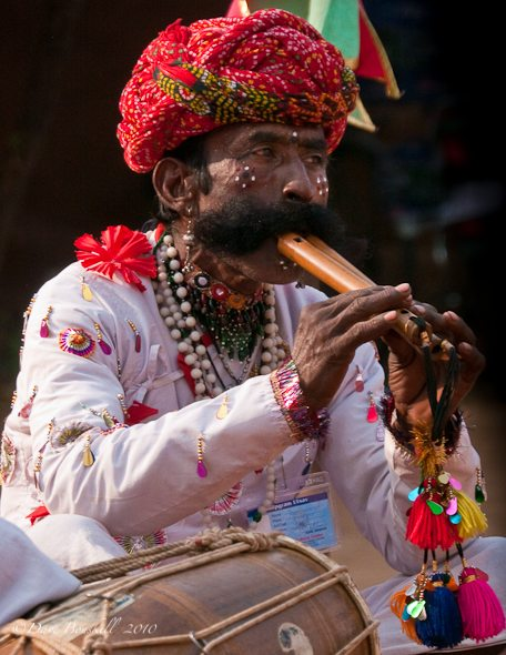 An Indian Musican playing flute