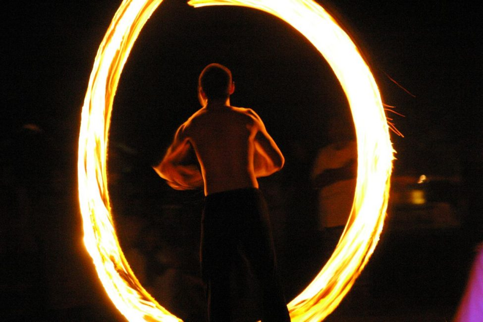 See a poi dancer spin Fire in Thailand