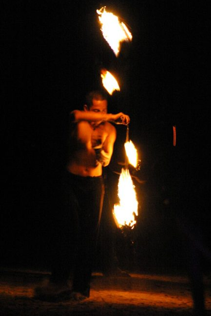 Firespinner on the beach performs in Thailand
