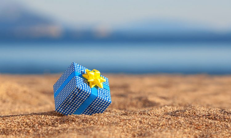 best gifts for travelers | travel gift box on beach