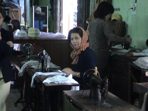 seamstress designs clothes in Hoi An