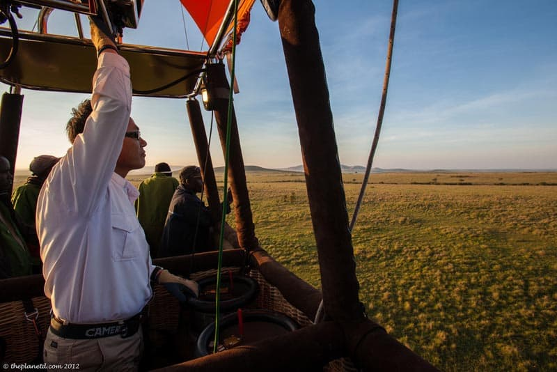 flying low in a hot air balloon over the masai mara
