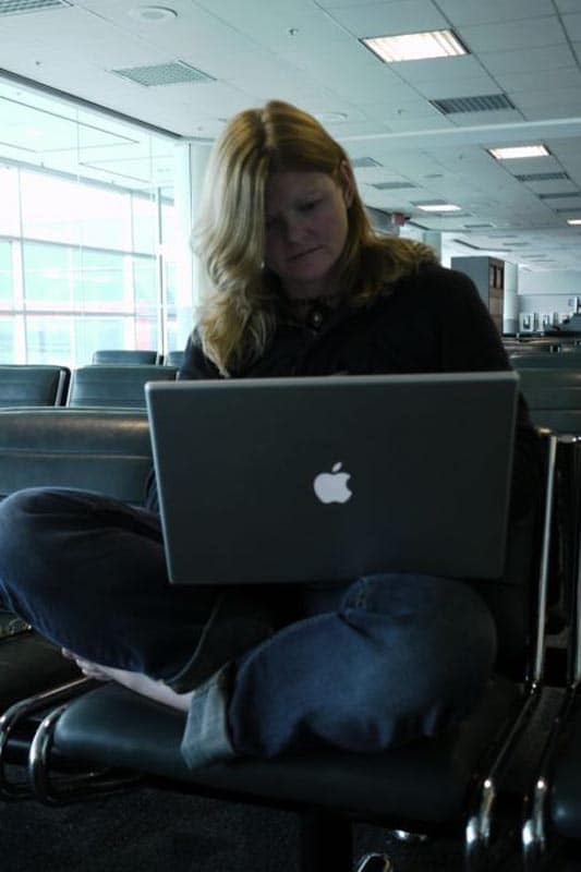 deb travel blogger working at airport