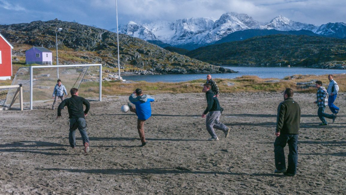 Itelliq kids join in on a soccer game.
