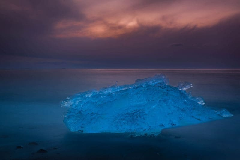 sunset over iceberg on beach iceland