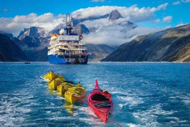 Kayaks being towed to our paddling location in Greenland