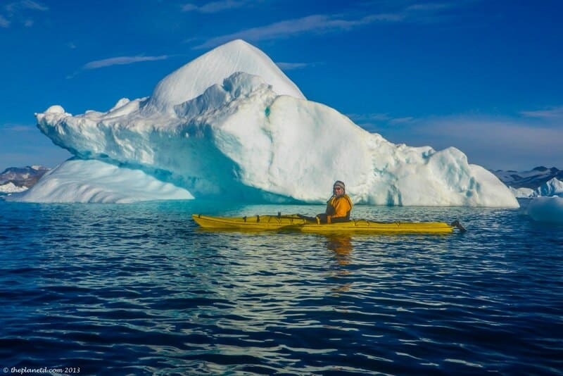 kayaking in Greenland safe distance from iceberg