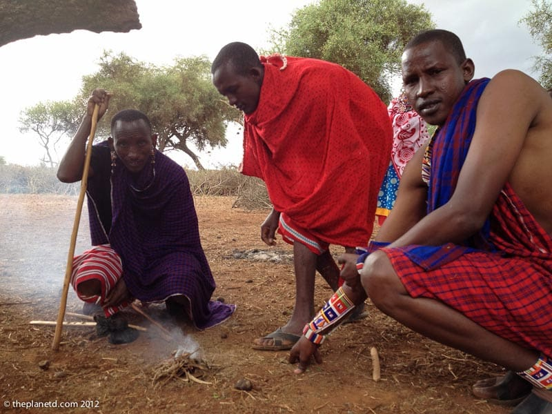 masai men making fire