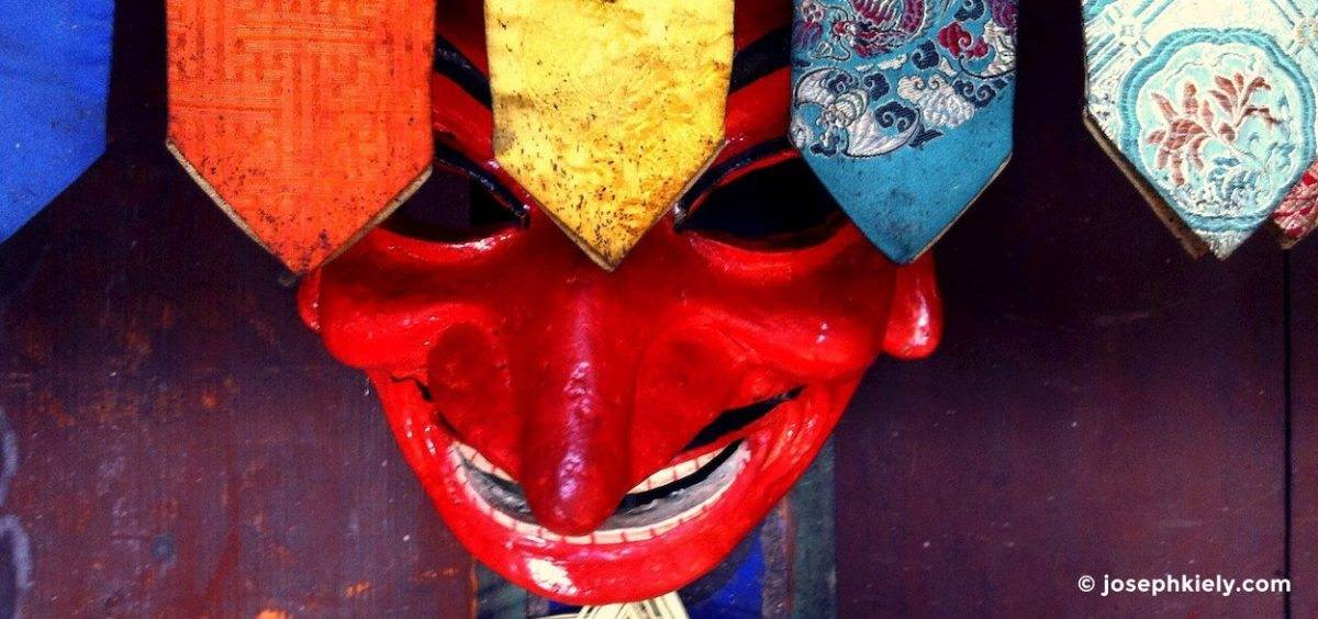 mask hanging on the wall in Bhutan