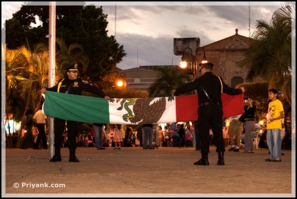 guards holding mexican flag