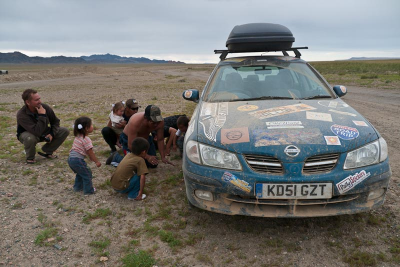 mongol rally car being fixed by locals