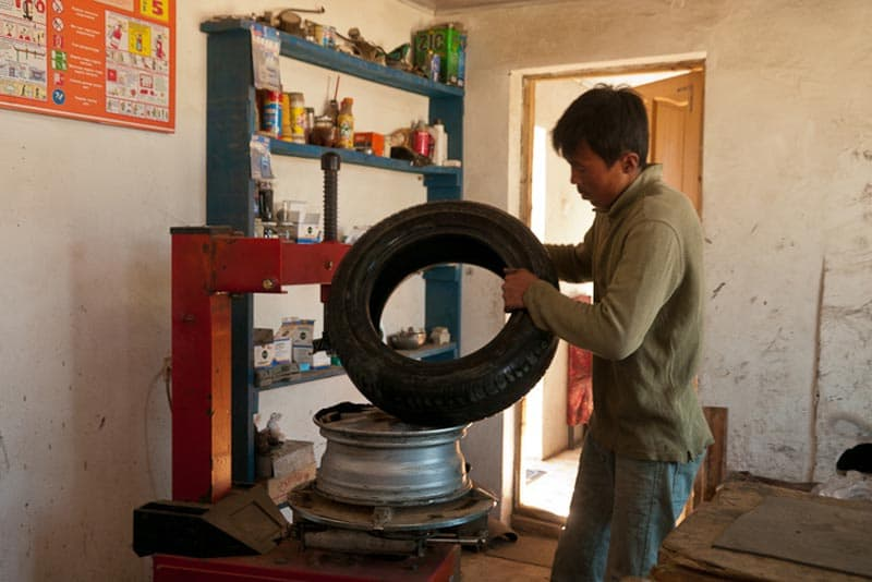 Mongol Rally getting tires fixed