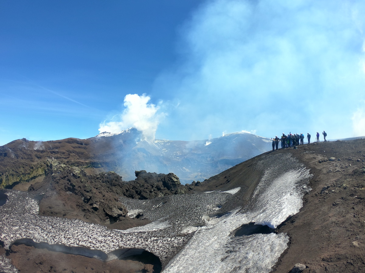 mount etna hiking tour group looking over craters