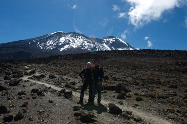 adventure couple posing in front of mount kilimanjaro