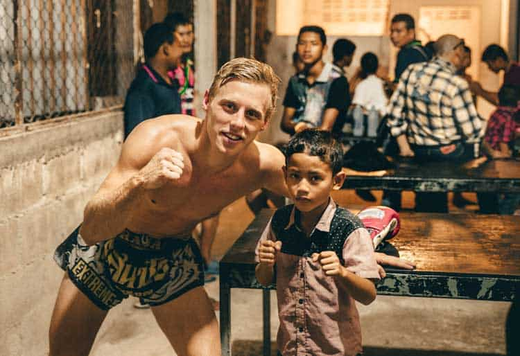 muay thai training in thailand | posing with young boy