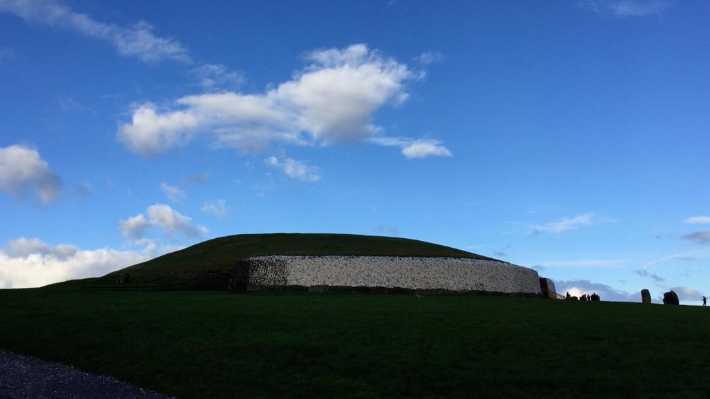 new grange mound surrounded by stone circle