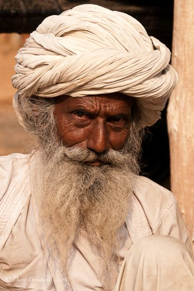 An old man from India with beard and wrinkles in face