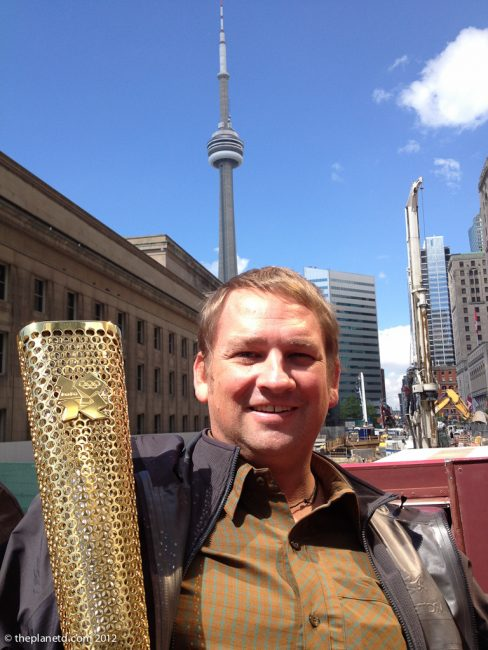 travel blogger dave with olympic torch