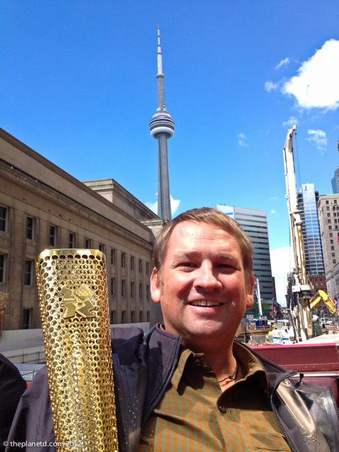Half of Adventure couple Dave with Olympic Flame in toronto