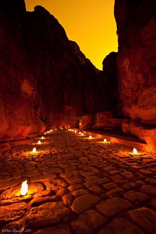 Petra is lit by candles at night
