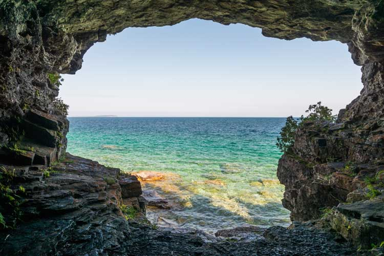 One of the best places to visit in ontario is the Tobermory Grotto
