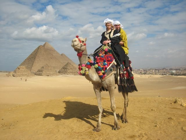 photo of couple on camel at Pyramids of Giza