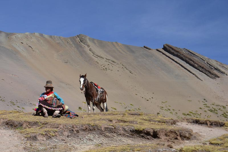 peru man with horse on our trek up Rainbow Mountain