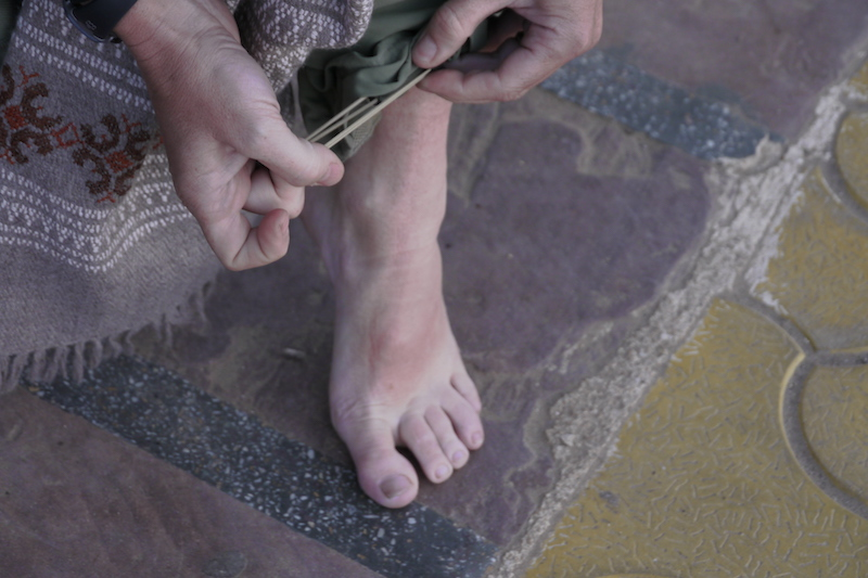 bare feet at the rat temple