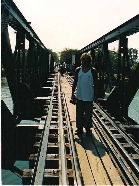Man on Bridge on the river kwai in Thailand