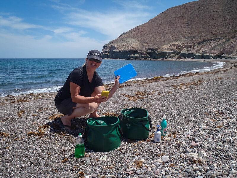 Baja, Mexico sea kayaking adventure Deb washing dishes