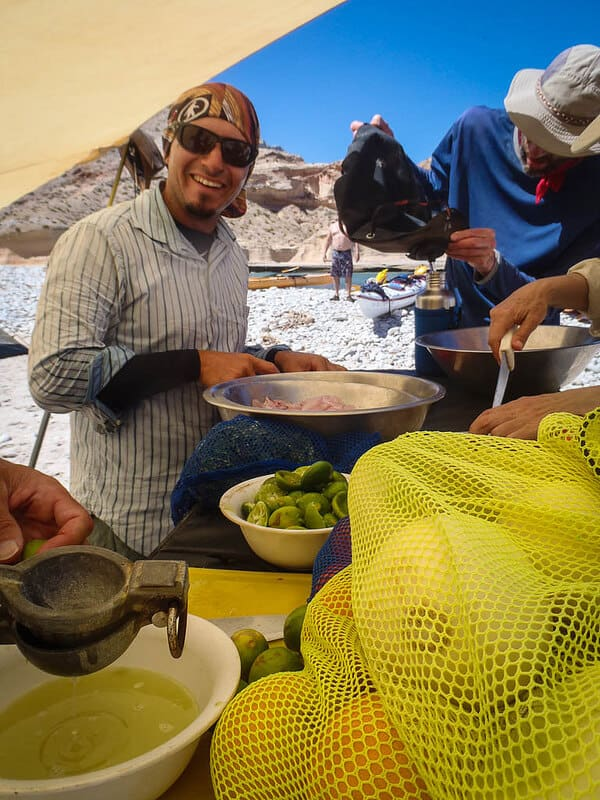 making ceviche on a self-sufficient sea kayaking trip in Baja, Mexico