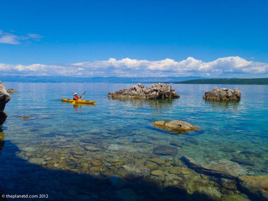 adventure couple kayaking in Croatia
