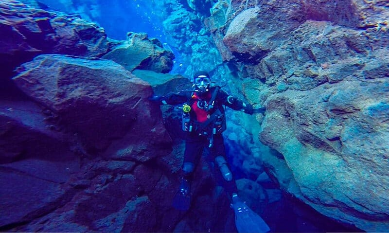 diving into the Silfra Iceland Ali touching both continental plates