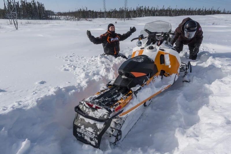 snowmobile quebec stuck in snow